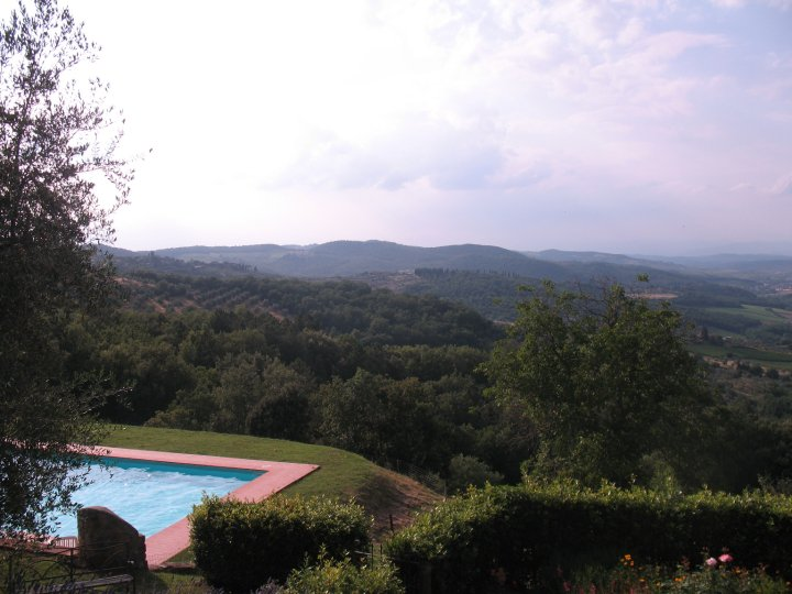 Panorama of the pool and landscape from the sun room