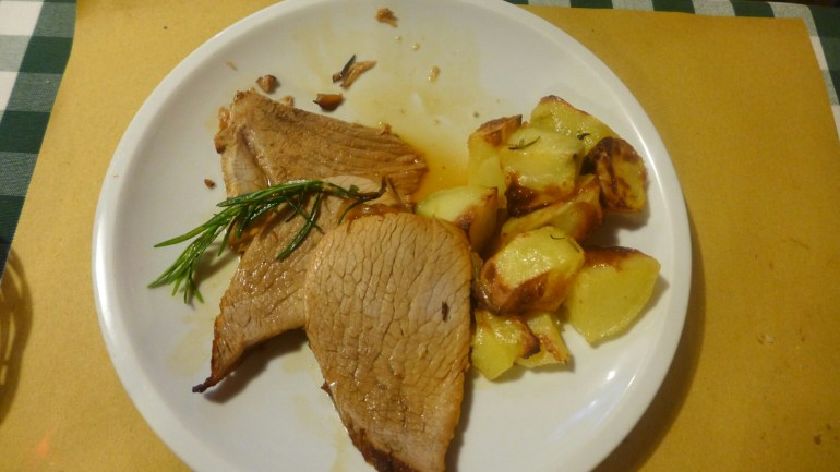Veal with a side of potatoes