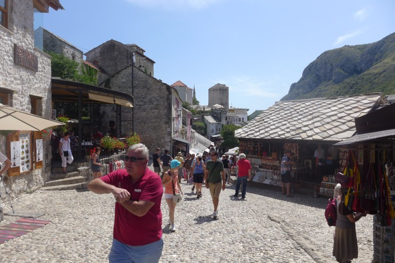 Snapshot of old town, shops and tourists