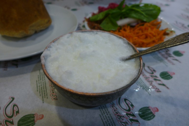 Ayran, a cold yogurt drink, served in a copper bowl