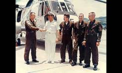 From left to right: Lt. Commander James E. Rylee, Lt. (j.g.) Donald G. Hartman, Chief Aviation Machinist's Mate William A. Brazzell, and Aviation Machinist's Mate C.V. Lindley. The four are being congratulated by Vice Admiral Robert E. Townsend. The helicopter used in the rescue is in the background. (Photo courtesy Bill Brazzell, Official Navy photograph)