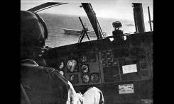 A CH-46 approaches the U.S.S. Guadalcanal.