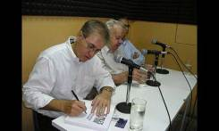 Author Emilio Corsetti, Balsey, and Tito during a radio show on the island of Curacao.