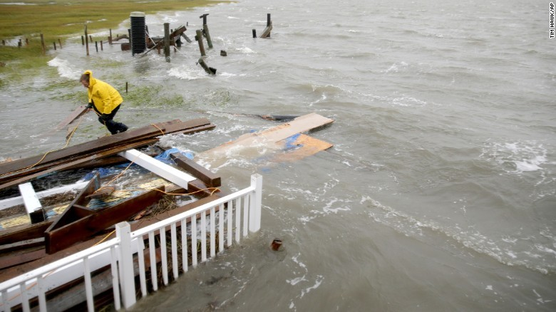 CATASTROPHIC FLOODING ALONG PARTS OF THE EAST COAST TODAY..Flash flooding has spread to South Carolina, residents are stranded in water in some locations.. There continues to be the 'once in 200 years' title added to the flooding in that state..Accuweather has a live blog runnnig on the flooding not only in South Carolina but also along the ATLANTIC coast line..I have seen a number of videos this morning showcasing moments when the ocean is coming onto the land and gobbling up parts of properties build dangerously close to the Atlantic .. This is NOT because of Hurricane Joaquin–that storm is racing to Bermuda and will cause all sorts of hell and havoc . This instead is because of a coastal storm