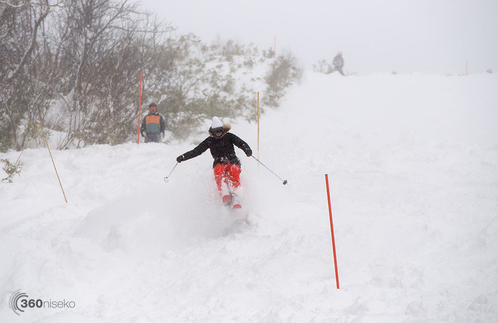 Christie Hampton floating over the powder on Yotei Sunset in Hanazono, 6 December 2014