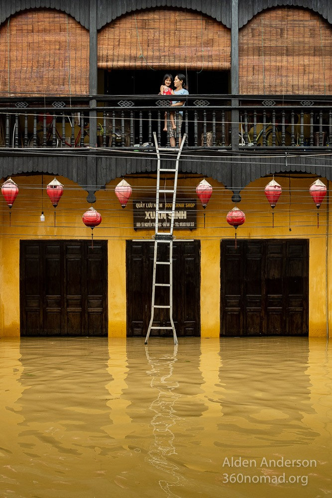 Nga with her daughter during the flood in Hoi An Vietnam