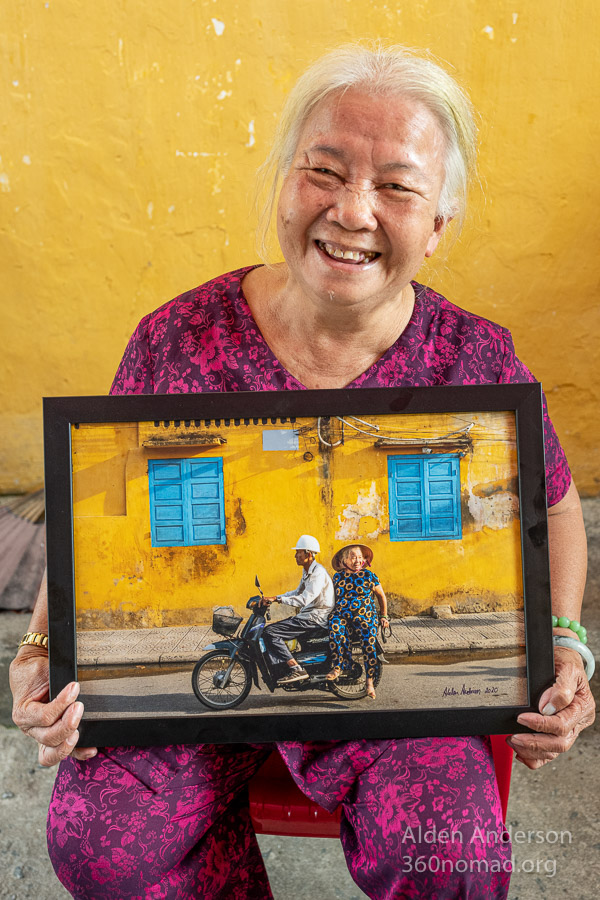 Hue with her photo. Hoi An, Vietnam