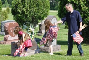 Mary and Kate Tierney with their dad at Evergreen Cemetery