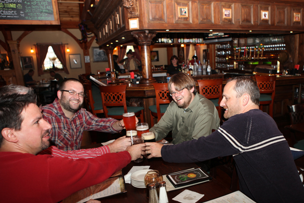Patrons Toast Over Beer at the Onion Pub & Brewery in Lake Barrington - Photographed by Julie Linnekin