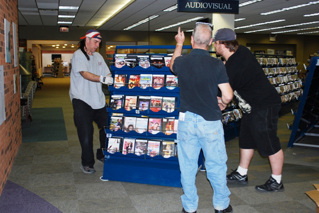Moving the DVD's at the Barrington Area Library - Courtesy of Karen McBride