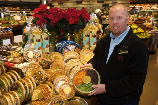 Produce manager Ken McKeel shows off some of Heinen's holiday samplers - Photographed by Julie Linnekin