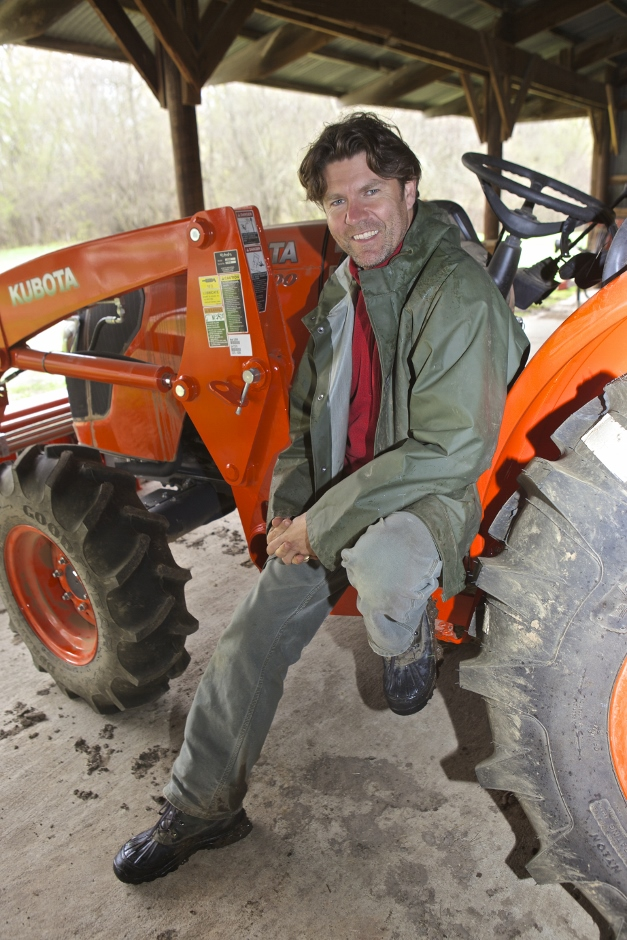Dominic with his newest investment, a Kubota LA844 - Photographed by Julie Linnekin