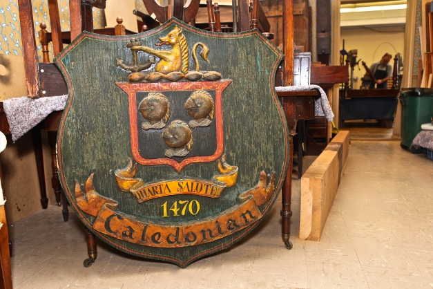 Caledonian's hand-carved sign, which was made in England - Photographed by Julie Linnekin
