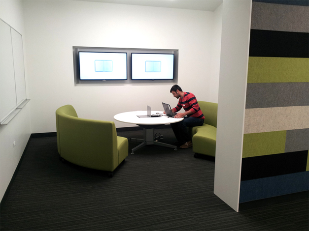 The library's Digital Services Manager Mike Campagna tests out equipment in one of the new media:scape rooms