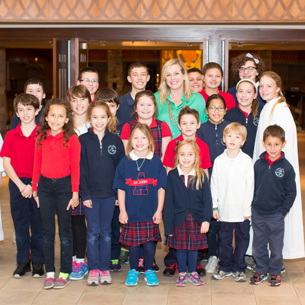 St. Anne Parish School Principal, Dawn Kapka, with St. Anne students - Photographed by Sally Roeckell