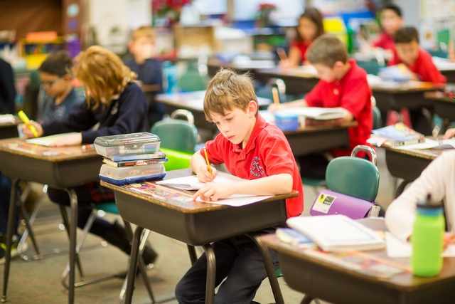 A St. Anne student hard at work - Photographed by Sally Roeckell
