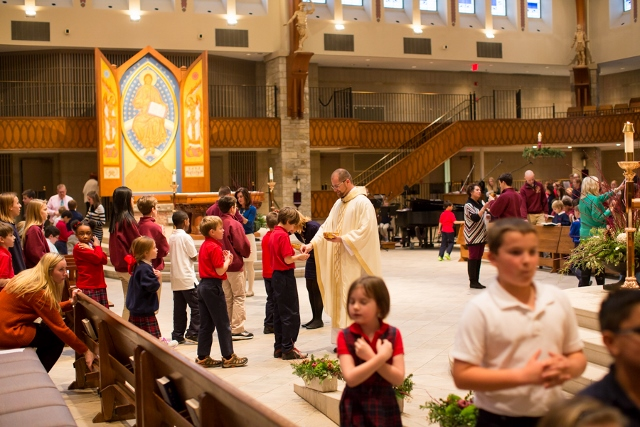 Father Bernie Pietrzak leads an all-school mass - Photographed by Sally Roeckell
