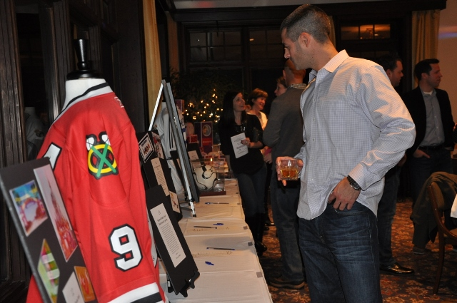 Hough parent Sherman Shechtman checks out the silent auction items - Photographed by Liz Luby
