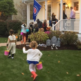 Trick-or-Treating and a #Cubs flag. The best!