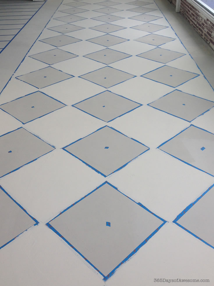 How I painted my concrete skim coated floors with Annie Sloan Chalk Paint in French Linen and Old White, both in a checkered square on the diagonal and wide stripes.