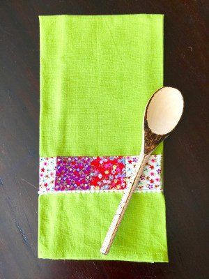 scrap fabric the towel and wooden spoon
