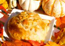 Baked Brie in Puff Pastry with Candied Pecans and Maple Syrup - an ooey, gooey, all melty warm cheese party appetizer literally dripping off your crackers while you scoop the maple syrup sweetened brie cheese with candied pecan bites into your mouth   365 Days of Easy Recipes