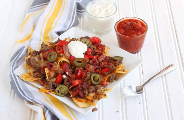 These Bacon Double Cheeseburger Nachos may be having a bit of an identify crisis. You'll find all the typical ingredients of a Bacon Double Cheeseburger piled high onto crispy corn tortilla chips | 365 Days of Easy Recipes