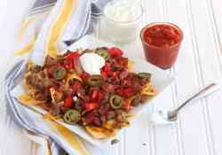These Bacon Double Cheeseburger Nachos may be having a bit of an identify crisis. You'll find all the typical ingredients of a Bacon Double Cheeseburger piled high onto crispy corn tortilla chips   365 Days of Easy Recipes