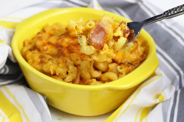 This Homemade Bacon Macaroni and Cheese is super easy to make and packed full of ooey gooey cheese making it the perfect comfort food during those cold winter months.