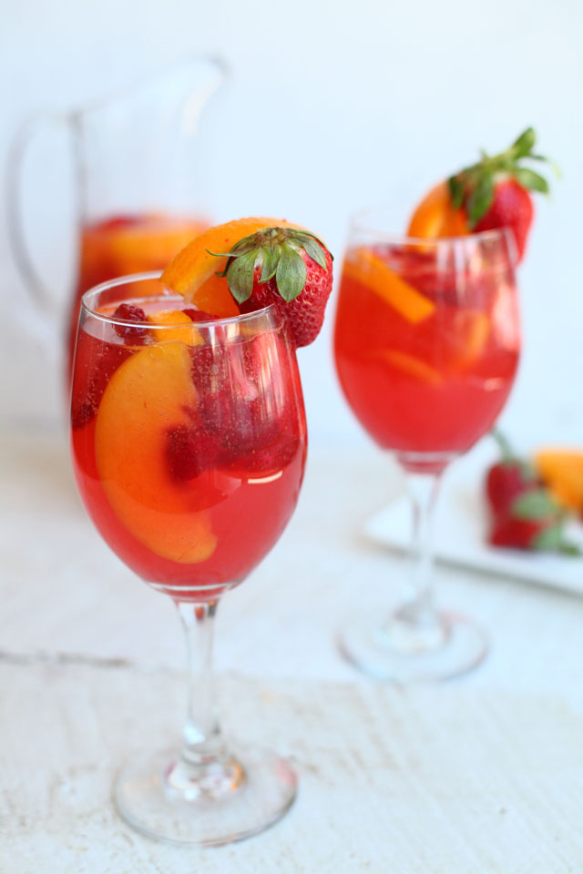 Make this strawberry peach sangria your drink of choice this summer. This light and fruity sangria is perfect for hot summer days lounging in the backyard or for a special Ladies Night In. #sangria #summerdrink #wine #drink