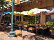 Fun colors with the umbrellas and produce.