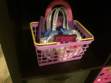 Basket to hold all the purses for guests who need to shop.