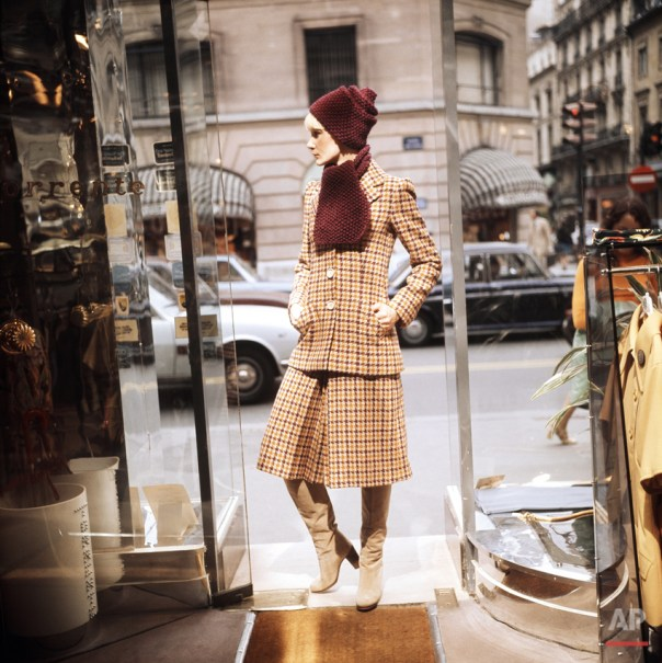 A suit in beige, tan and violet checkered wool from the 1974-75 Fall and Winter collection of Paris Torrente fashion house, July 17, 1974. Long vest is worn over a below-the-knee culotte skirt a violet wool bonnet and scarf give the sophisticated touch. (AP Photo)
