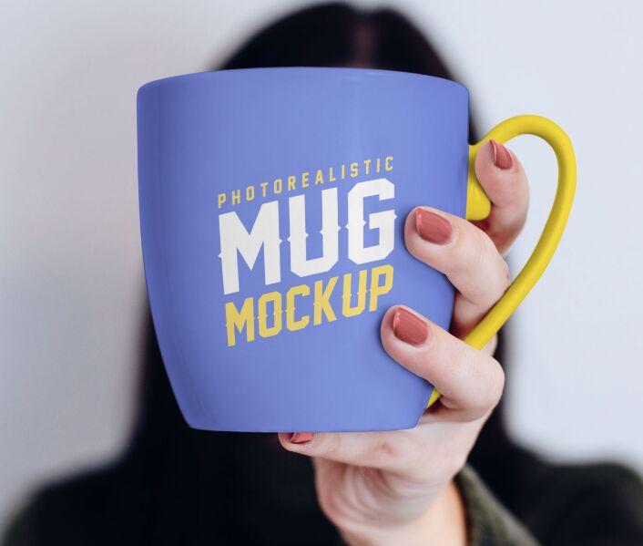 Mug in Female Hand Mockup PSD
