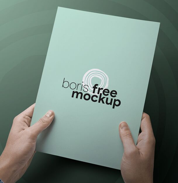 PSD Hand holding A4 Paper Mockup