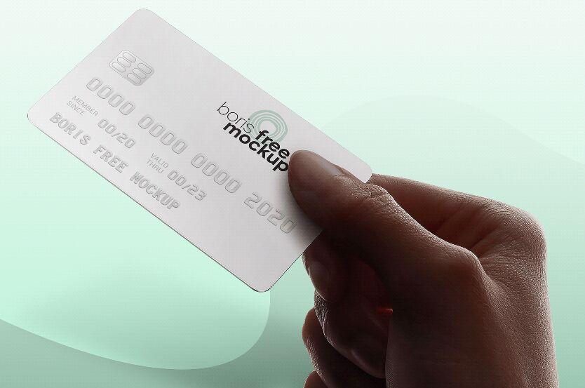 Hand Holding Credit Card Mockup PSD Freebie
