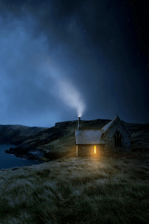 rosiesdreams:</p> <p>Somewhere ..   Photo by David Soar </p> <p>I love this picture.<br /> It brings many images to mind.<br /> An isolated cabin somewhere on a rise<br /> of land near a small body of water.<br /> Darkness is surrounding the cabin<br /> but there's a light inside.<br /> Smoke is drifting upward from the chimney.<br /> Someone is home.<br /> Who lives there?<br /> Why would someone want to live<br /> far from the madding crowd?<br /> Does the person ever feel lonely?<br /> I don't see a car.<br /> How does this person travel?<br /> I want to peek into the window.<br /> Should I?