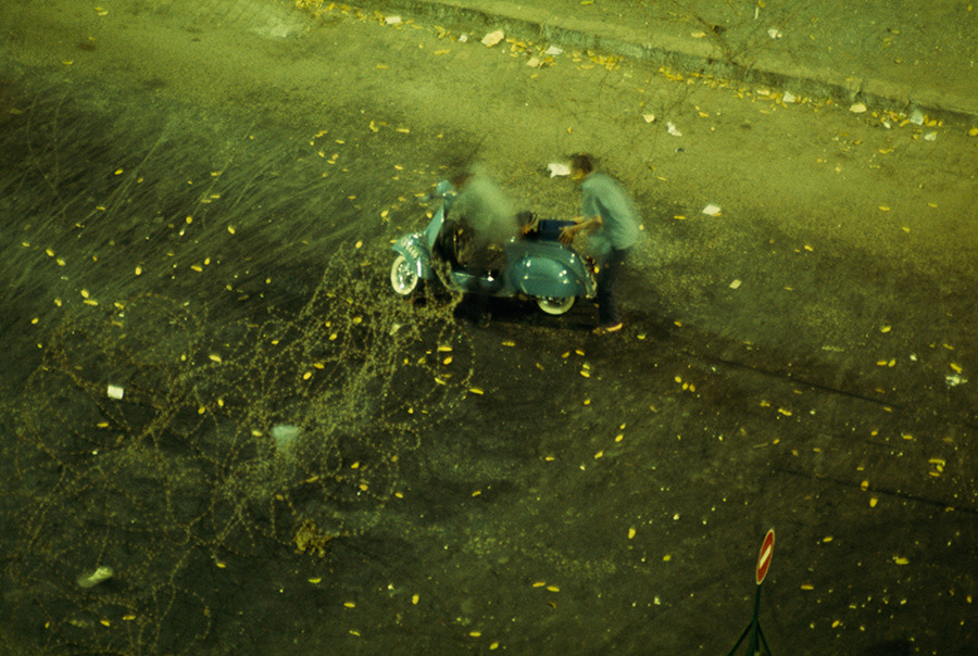 Two men struggle to free their scooter from a barbed-wire barricade in Saigon, South Vietnam, 1965.Photograph by W. E. Garrett, National Geographic Creative