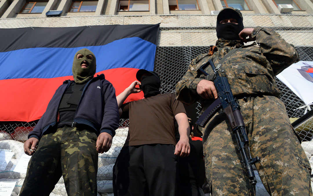 As tensions remain high in eastern Ukraine, pro-Russia separatists detained three Ukrainian State Security Service agents in Horlivka this weekend, while a masked pro-Russia militia seized a television station in Donetsk.