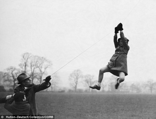 1930s</p> <p><br /> A young girl in London hangs on to the string of a kite.</p> <p><br /> (via Mail Online)