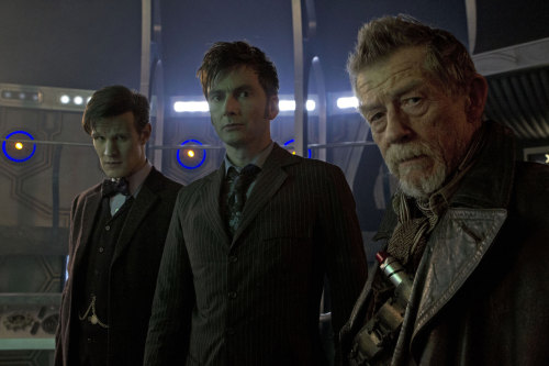 """jelizabethl: doctorwho: The first in-studio image of Matt Smith, David Tennant, and John Hurt from the set of'The Day of The Doctor.' Don't close your dash as we have a few more images coming in a bit…. !!!!!!!! A couple things on this: 1. I spent my summer watching all seasons of the new Doctor Who specifically because everyone talks about it on Tumblr and I wanted to see what all the fuss was about. 2. Oh my god this show is phenomenal. If you are not watching it, start! 3. This show had the ability to make me fear and hate little talking vacuum cleaners. S-C-A-R-Y! Exterminate!!! 4. The Day of the Doctor is the same day as Ryan's birthday. This news excites me a lot more than him as he is not so terrified of little talking vacuum cleaners. 5. There is a Doctor Who centric blog??? Excuse me while I click """"Follow:"""""""
