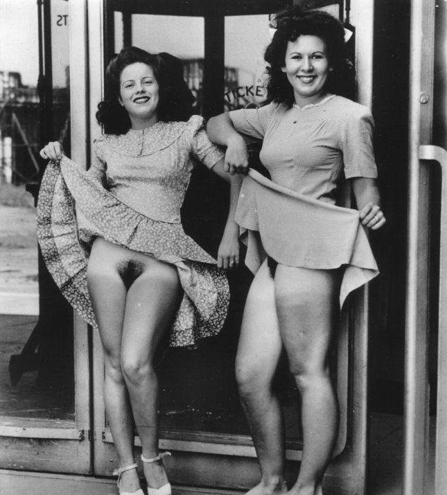 Waiting for their sailor husbands to disembark a returning WWII troop ship? Gorgeous dames!