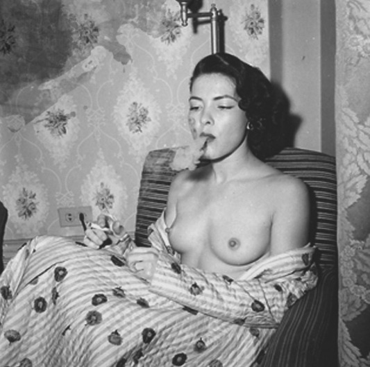 Hot retro dame smoking. And her nipples are erect, too.