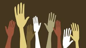 A graphic of many hands raised in the air, indicating people voting