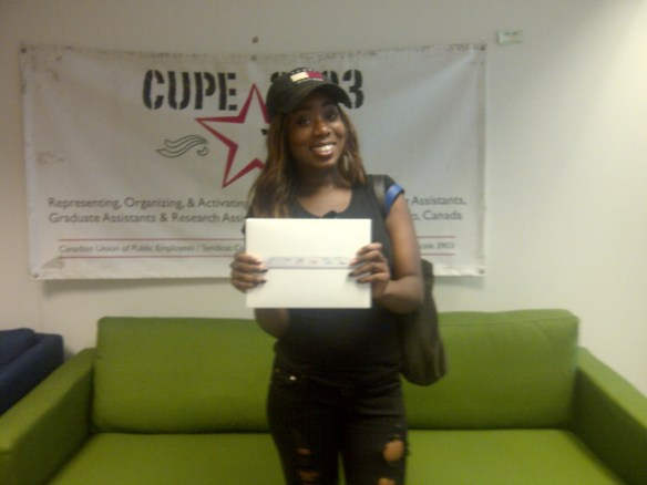 The lucky winner of the iPad draw poses with her prize.