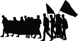 Silhouettes march with banners and flags.