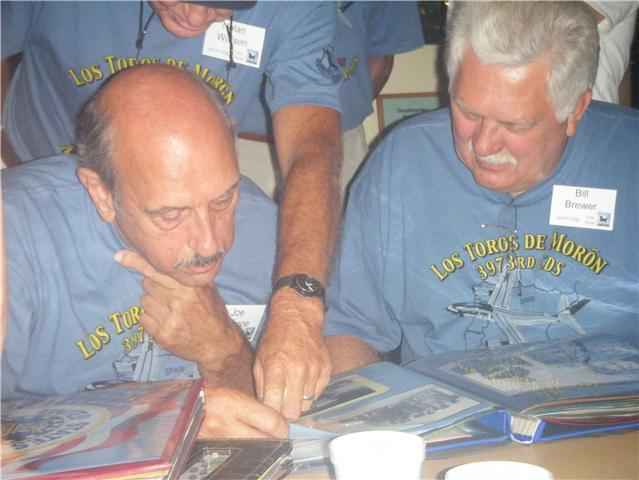 JOE VACCONE, BILL BREWER POURING OVER OLD PHOTOS 2009