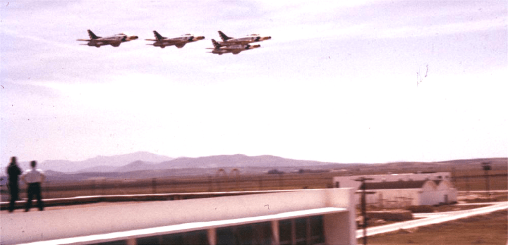 1000px Air show with F-100s flying over, couple spectators June 1959