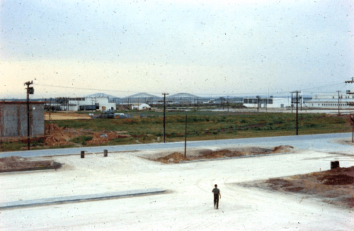 500px May 1958 view from airmen's barracks, motor pool area seen