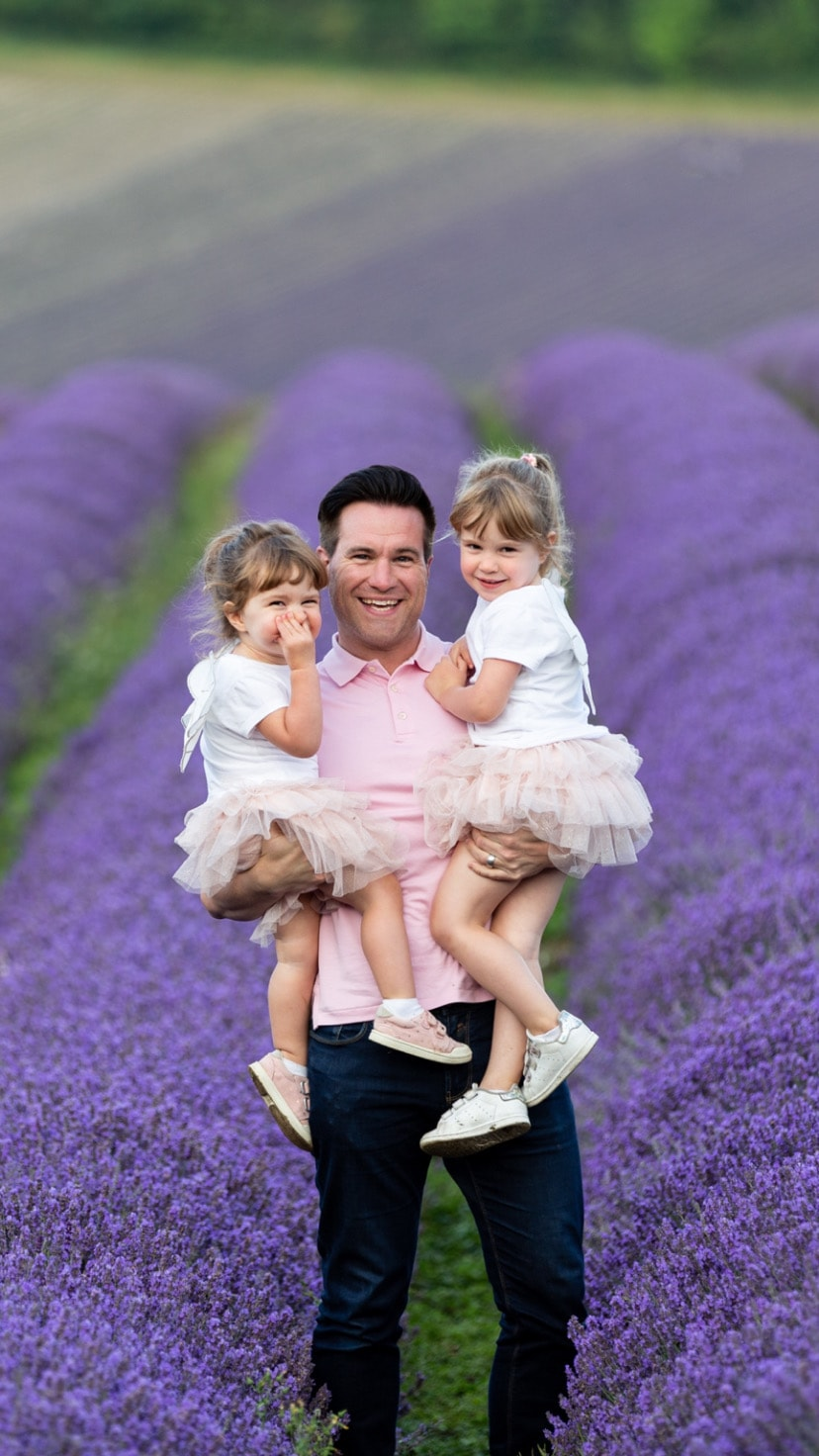 dad and his two daughters taken at their Kent family lavender photoshoot